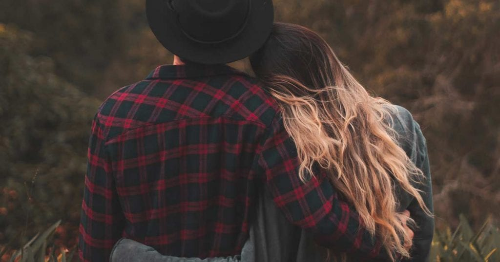 Couple on top of a hill