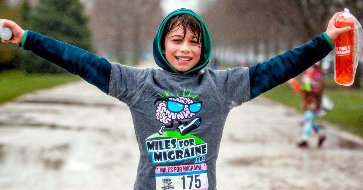A young boy crossing the finish line